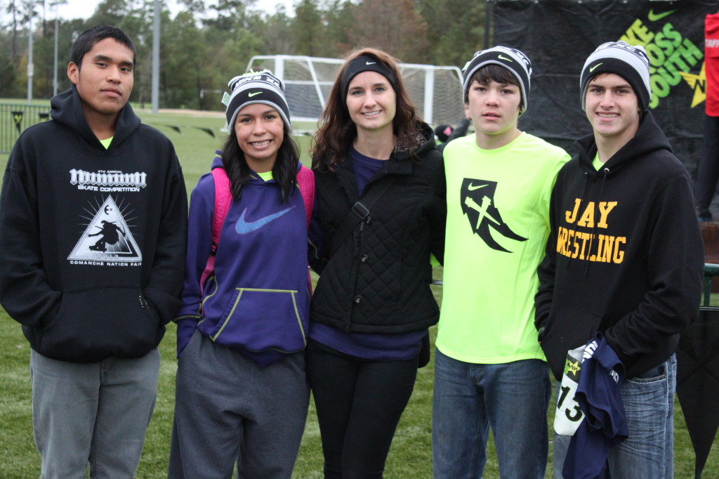 Wings athletes pose near the finish line of the NXN South championships on November 23rd in Woodlands, TX.