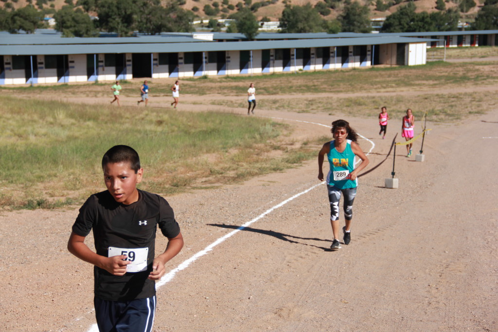 5K competitors battle up one of the last hills before making it to the long grass flats at the end.