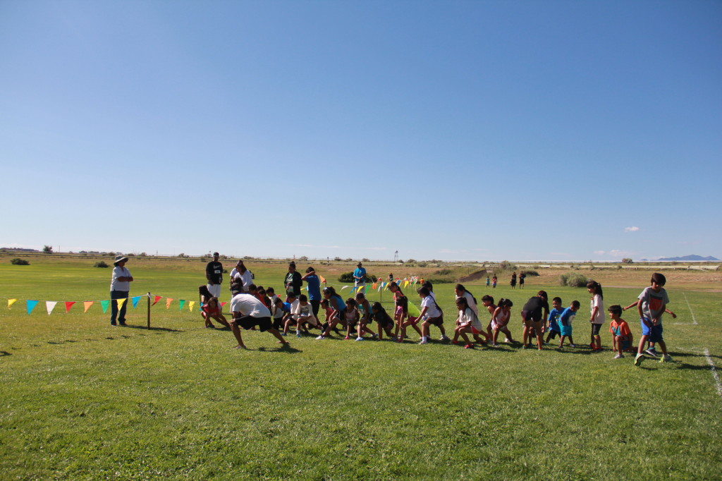 Competitors in the kids 2K warm up as a group before their race.