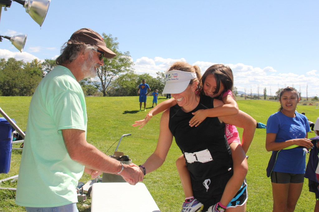 Wings founder and Board Chair congratulates the women's 4th place overall finisher, Kathryn Becker, on a job well done.