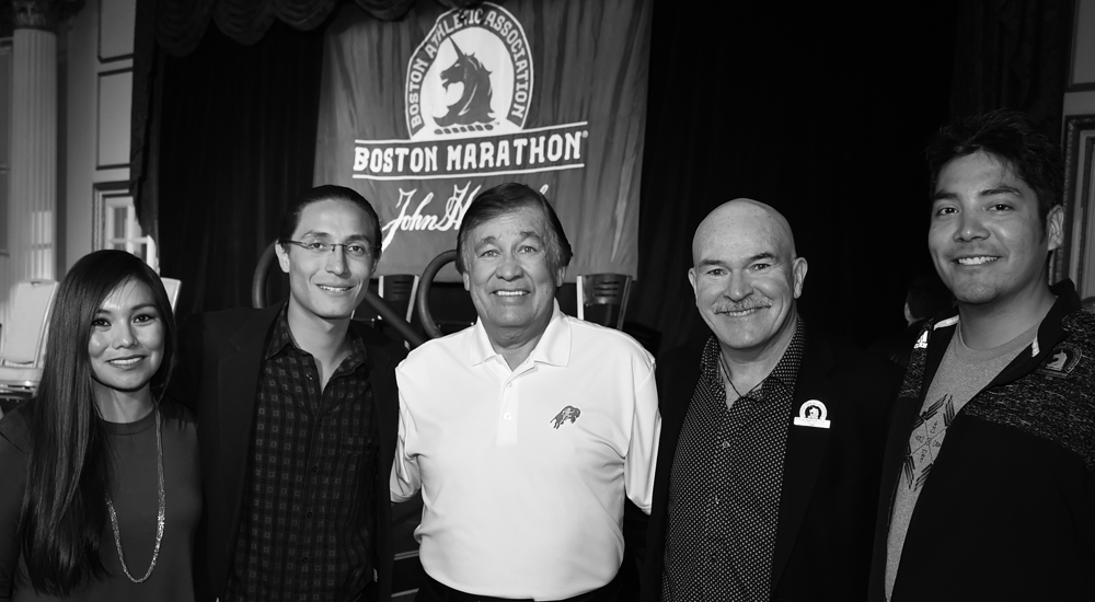 Wings runners pose with Billy Mills and Rob DeCastella, two time winner of the Boston Marathon and founder of the Indigenous Marathon Project. Photo: Jim Davis